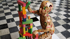 kid being creative with building blocks